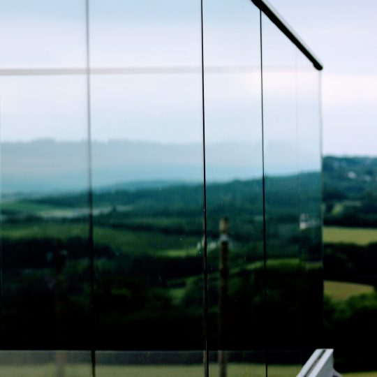 view from the side of frameless glass balustrade