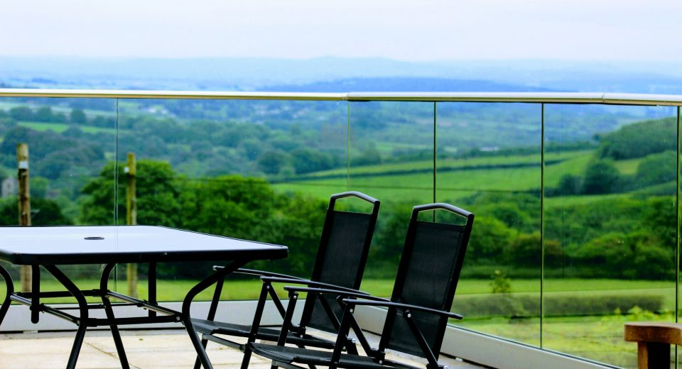 Solus frameless glass balustrade channel installed on a patio in Cornwall