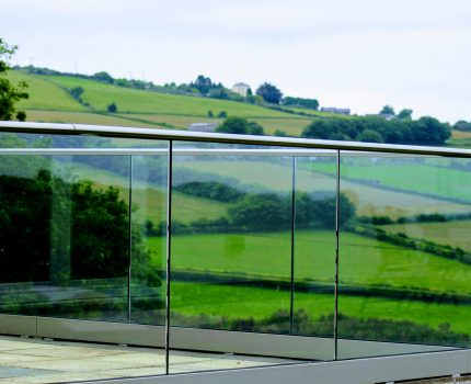 Frameless glass balustrade around a patio area in Cornwall