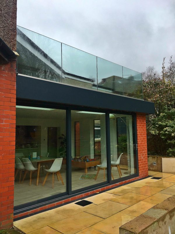 Frameless glass balustrade on a roof terrace by Vantage Balustrades