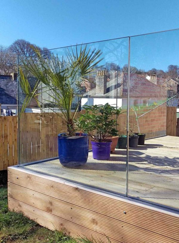 Solus frameless glass balustrade fitted to a wood decking in Cornwall
