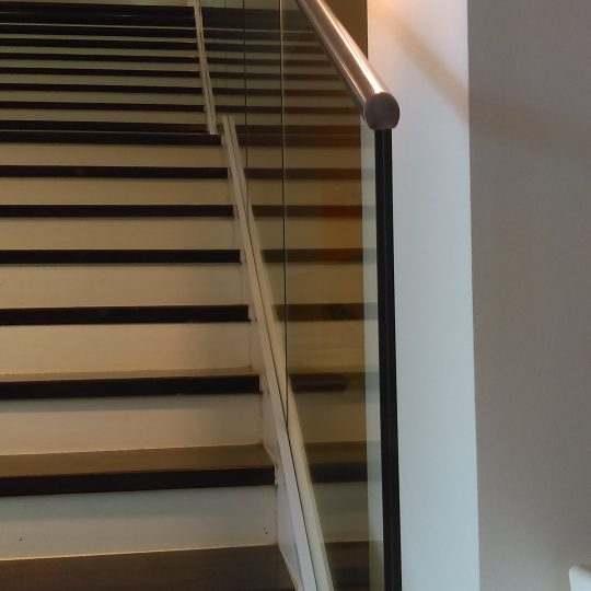 glass handrail down a stairs