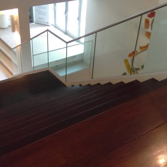 frameless glass balustrade going down a staircase