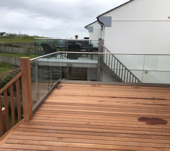 frameless glass balustrade installed on a wooden decking