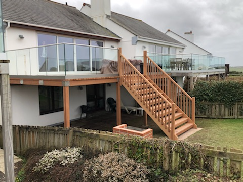 wood decking with our Solus glass balustrade system installed