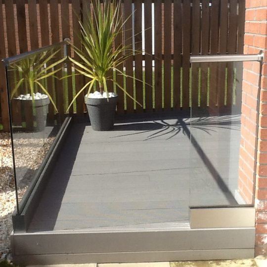 Glass balustrade on a composite decking