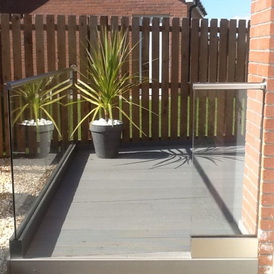Glass balustrade installed on a decking