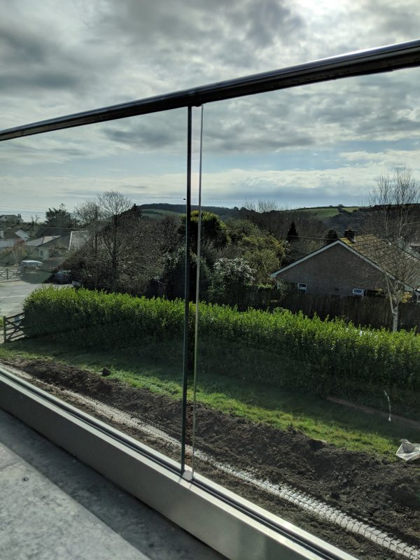 Frameless glass balustrade installed in near St Austell in Cornwall
