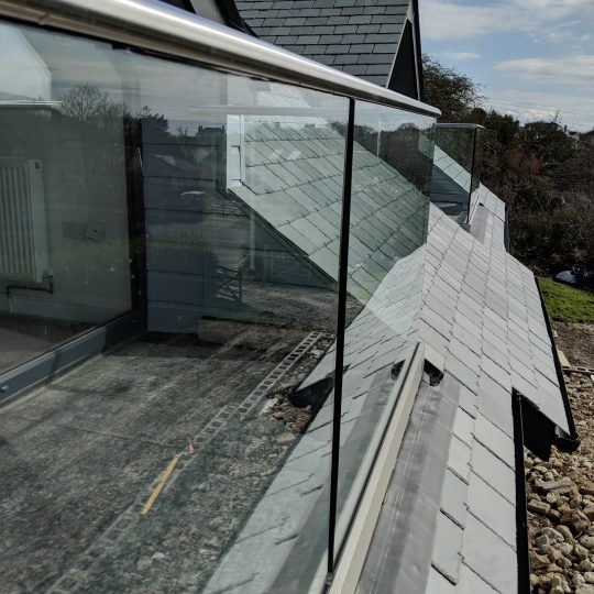 looking back on frameless glass balustrade