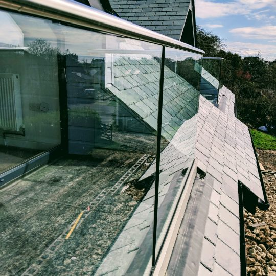 glass balustrade in cornwall installed on a dorma opening