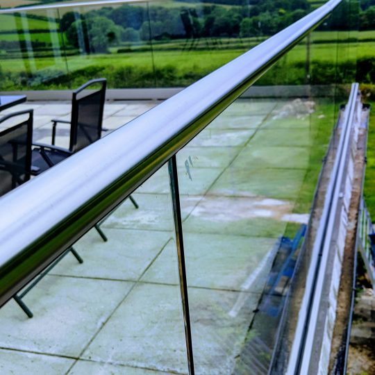 view of the frameless glass balustrade with handrail on