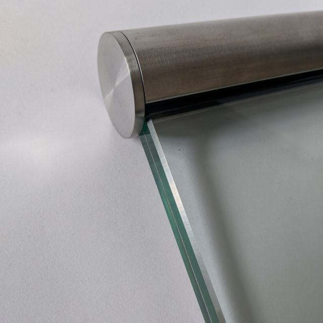 Stainless steel slotted handrail for use on frameless glass balustrades