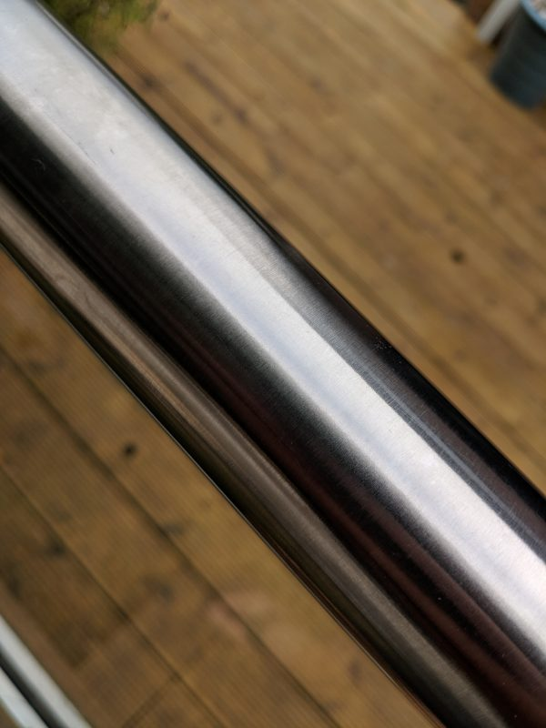 Glass balustrade slotted handrail