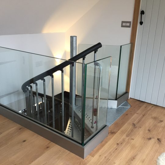 Frameless glass balustrade by Vantage Balustrades installed on a landing area in London