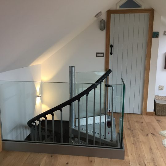 Glass balustrade around a landing area
