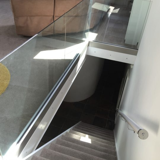 internal frameless glass balustrade on a landing