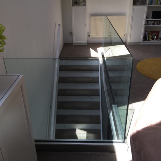 frameless glass balustrade around stairs