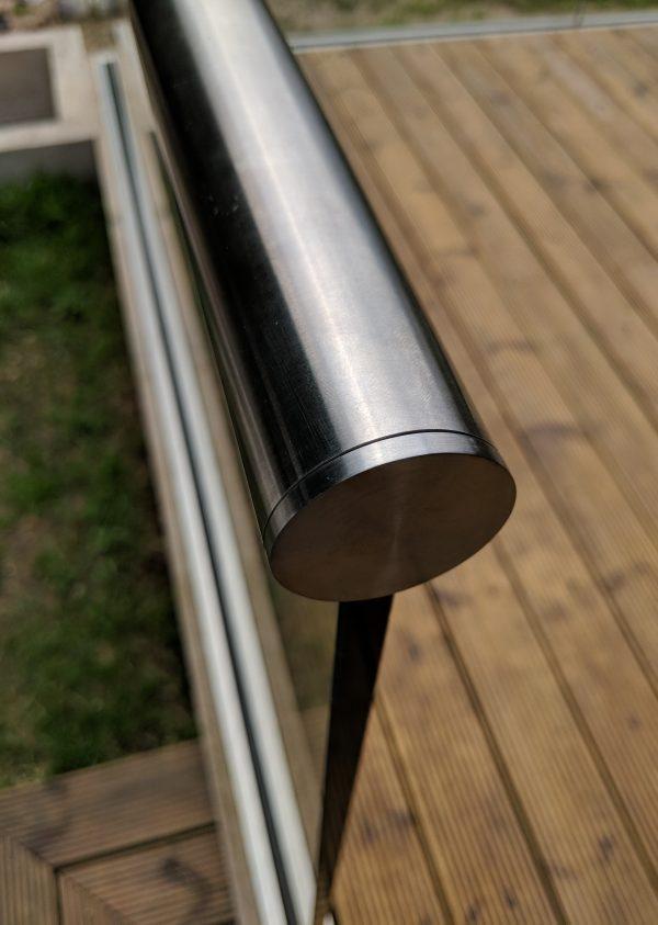 handrail end cap on frameless glass balustrade on decking