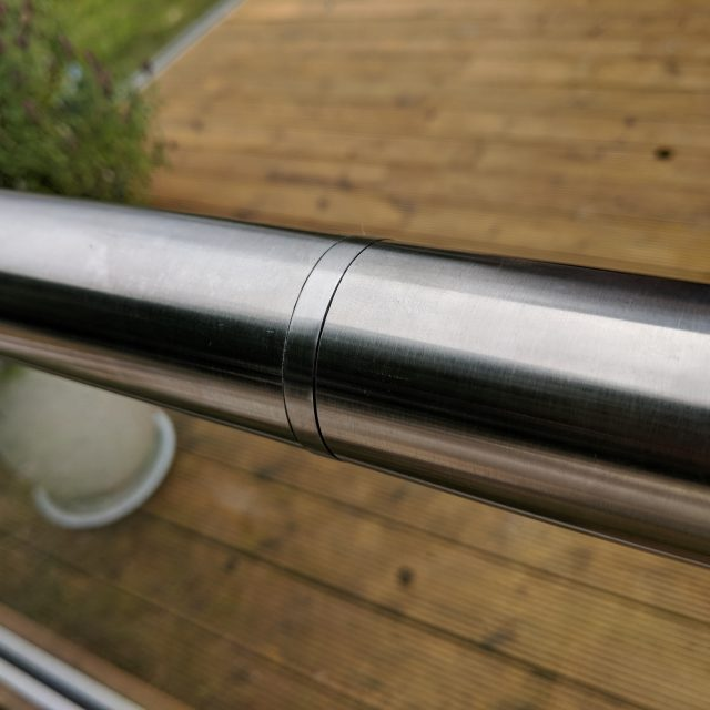 Slotted handrail connector for use on frameless glass balustrades