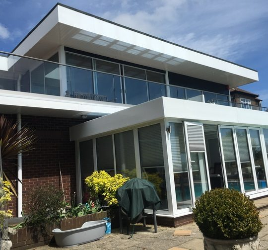 frameless glass balustrade installed on a house in dorset by vantage balustrades
