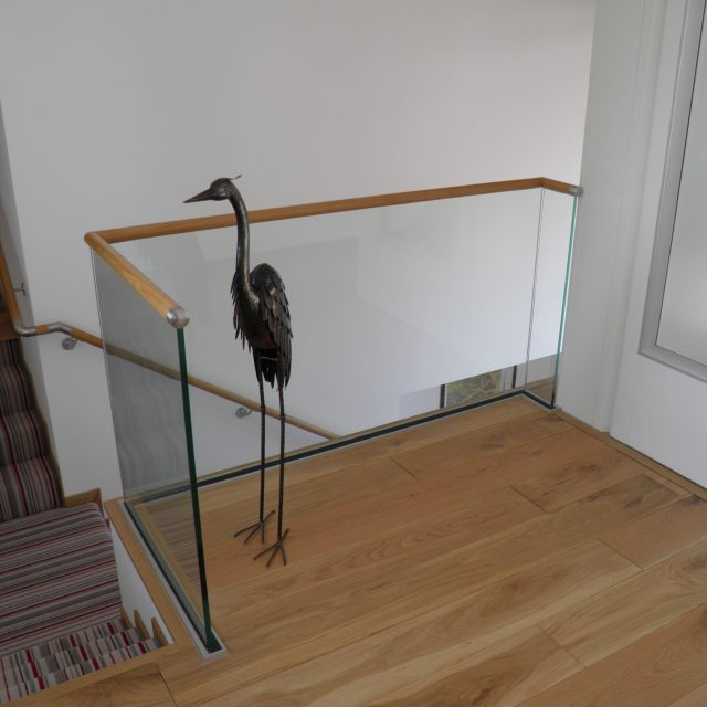 wood slotted handrail in oak